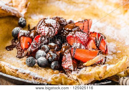 Dutch Baby Pancakes With Berries And Chocolate