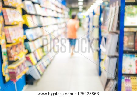 People Read A Book Blurred Background