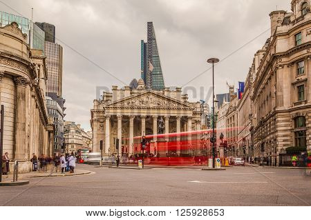 LONDON UK - 25TH MARCH 2015: The Bank of England during the day at Bank Junction showing buildings and the blur of people and traffic