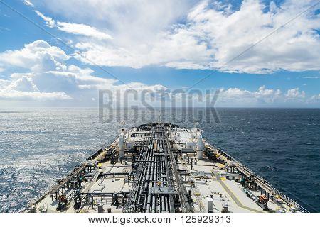 Grey oil tanker deck in the ocean - airview