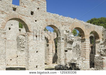 Arches of nave of early Christian basilica ruins at archeological site of Butrint South Albania