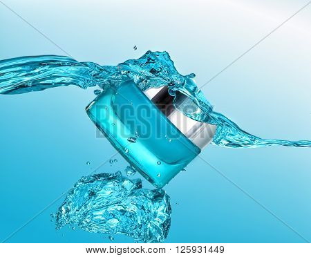 The blue jar of moisturizing cream in the blue water wave  with  air bubbles and water drops on the blue water background