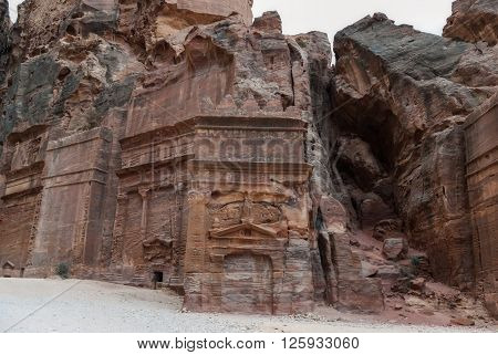 Street of Facades, riddling the walls of the Outer Siq. Ancient city of Petra, Jordan. The city of Petra was lost for over 1000 years. Now one of the Seven Wonders of the Word