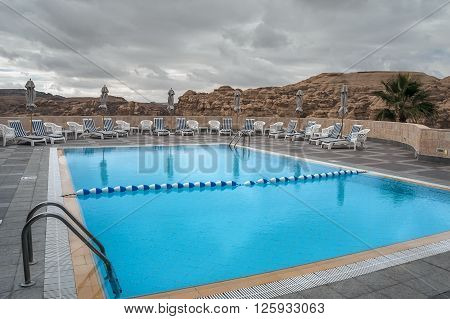 PETRA, JORDAN - NOVEMBER 22, 2007: Swimming pool overlooking the mountains. Petra. Jordan. The area for relaxing outdoors, with views of the mountains