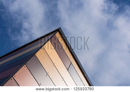 Detail of a colorful house wall with blue sky.