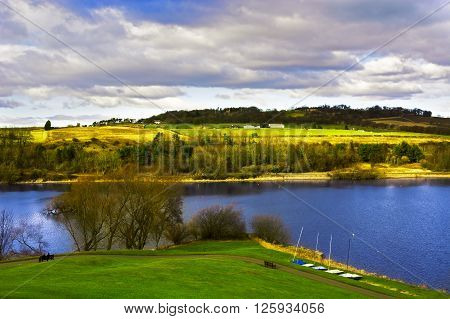 Linlithgow Loch in Spring under dramatic clouds