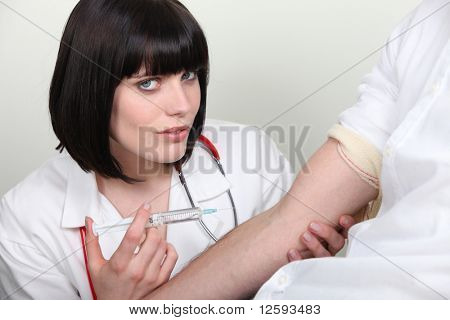 Portrait of a nurse with a syringe