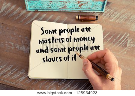 Handwritten quote Some people are masters of money and some people are slaves of it, as inspirational concept image