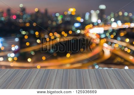 Opeing wooden floor, Blurred bokeh lights interchanged with city downtown background