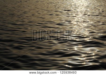 dark sea water and sunset path for background