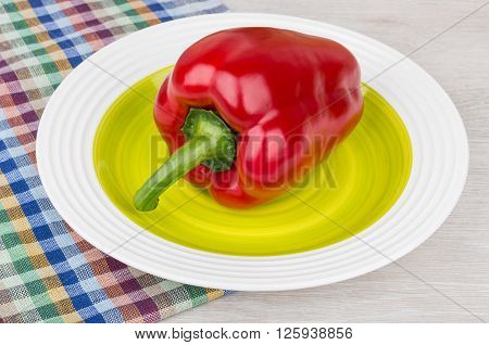 Raw Red Bulgarian Pepper In Glass Plate On Table