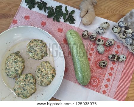 Cooking squash goutweed fritters with ginger and quail eggs, pancakes with wild plant