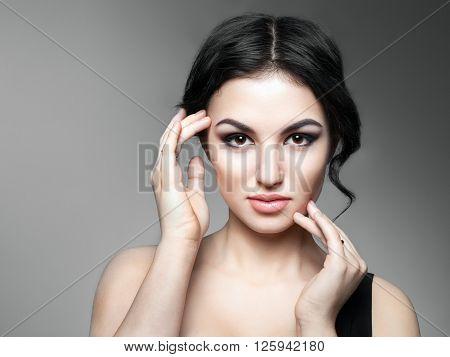 Beautiful Young Woman Touching Her Face. Fresh Healthy Skin.