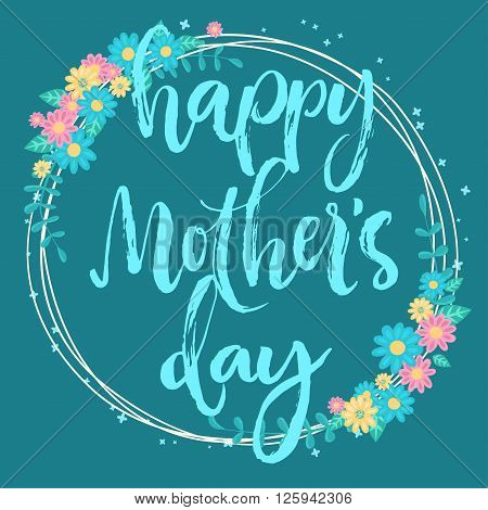 Happy mother's day lettering card. Floral circle frame on greenish blue background. Hand written brush letters.