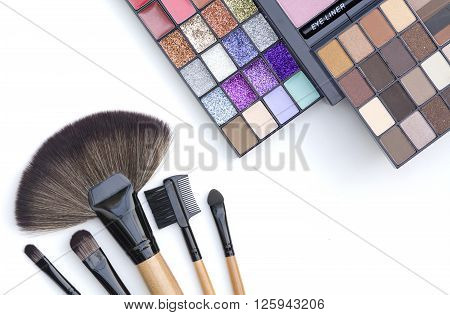 top view of selective focus professional natural tone makeup palette set on white background