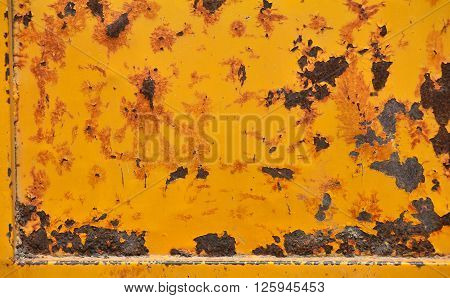 Grunge old yellow painted damaged rusty corroded yellow texture background with stains defects flakes and scales
