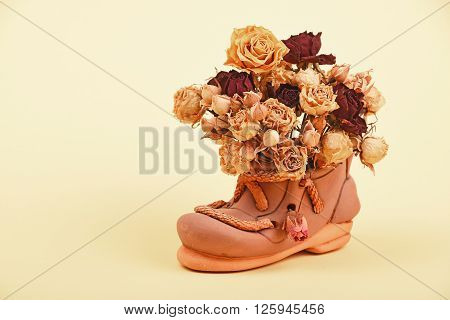 Dried Roses Bouquet In Ceramic Shoe