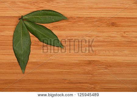 Three Bay Leaves In Bamboo Wooden Board Corner