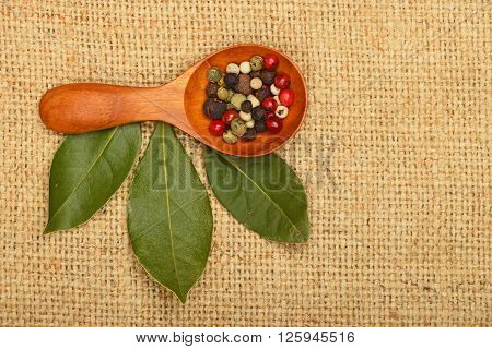 Bay Leaves And Peppercorn Scoop On Burlap Canvas