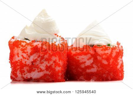 Two Japanese fusion rolls with red roe and cream cheese isolated closeup