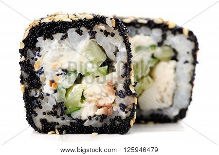 Two Japanese square rolls with black tobiko roe sesame seeds and vegs isolated closeup