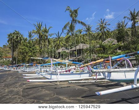Tropical Beach With Fishing Boats And Palm Trees In Baki