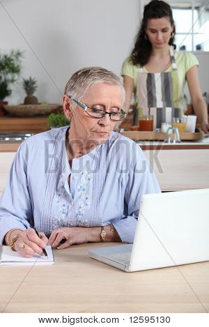 Senior woman in front of  laptop computer