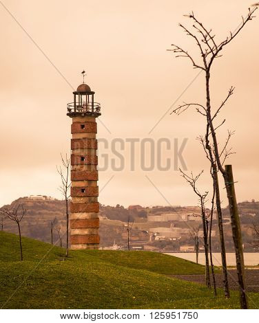 The old stone lighthouse in belem portugal ** Note: Shallow depth of field