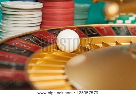 casino roulette wheel with the ball on number 5