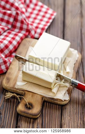 sliced butter on a board and knife