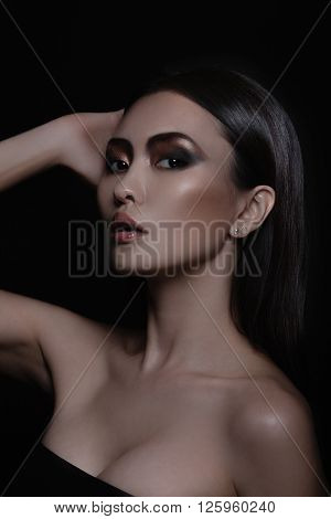 Sexy asian model with fashion evening elegance shining makeup. Cosmetics and make-up