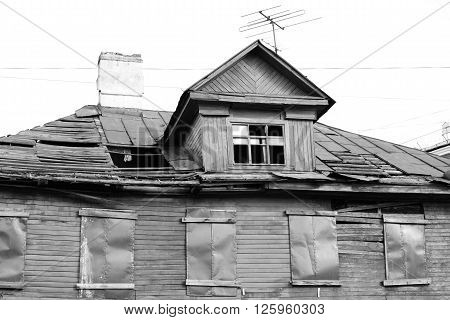 Abandoned wooden building in Kolpino town on the outskirts of St. Petersburg Russia. Black and white.