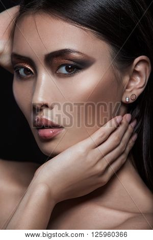 Asian model with fashion evening elegance shining makeup. Cosmetics and make-up