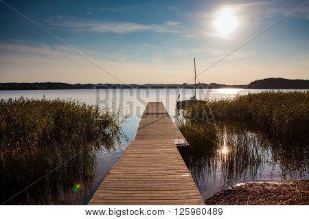 Zarasas lake with a pier and boat in Zarasai town Lithuania.