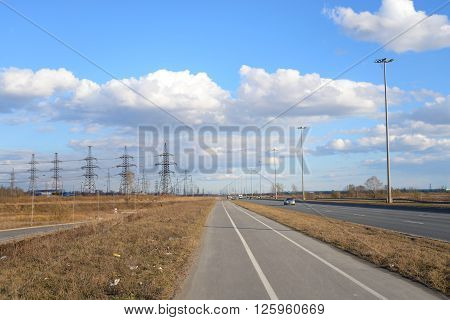 Bike path on the outskirts of St. Petersburg at sunny day Russia.