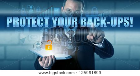 Data manager is pressing PROTECT YOUR BACK-UPS! on a virtual touch screen interface. Business risk metaphor and information technology concept for security of your backed-up corporate data.