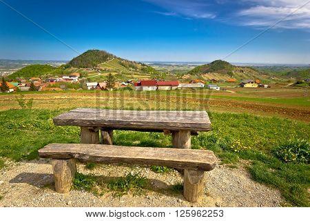 Idyllic mountain village of Prigorec bench and landscape under Ivanscica mountain Zagorje Croatia