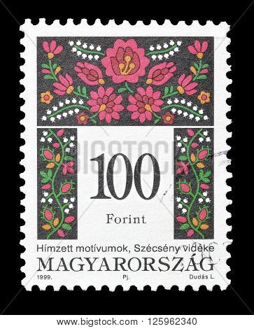 HUNGARY - CIRCA 1999 : Cancelled postage stamp printed by Hungary, that shows Folk motive.