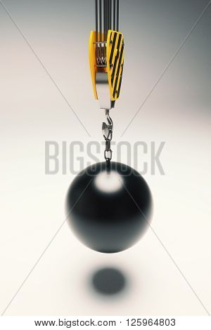 Crane hook with wrecking ball on light grey backgound. 3D Rendering