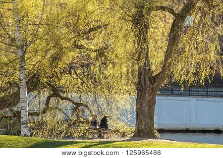 NORRKOPING, SWEDEN - APRIL 19: Young women enjoy sunshine on April 19, 2014 in the industrial landscape of Norrkoping. The historic industrial landscape has become a major tourist attraction.
