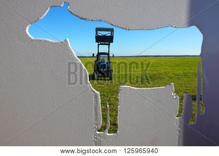 Tractor in a farmer field.Background of agriculture industry