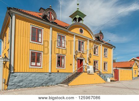 MARIEFRED, SWEDEN - AUGUST 4: The historic Town Hall on August 4, 2011 in Mariefred. This historic idyllic small town on Lake Mälaren is a popular tourist destination during summer