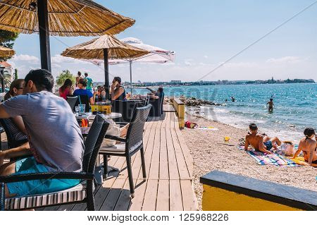 Zadar, Croatia - July 28, 2015: Tourists And Various Guests Sitting At The Bar By The Sea And Enjoy