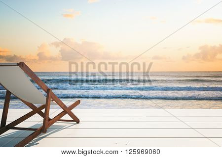 Chaise longue on wooden surface at the seaside. Mock up 3D Rendering