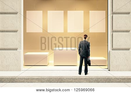 Frontview of showcase exterior with blank labels stand and businessman. Mock up 3D Rendering