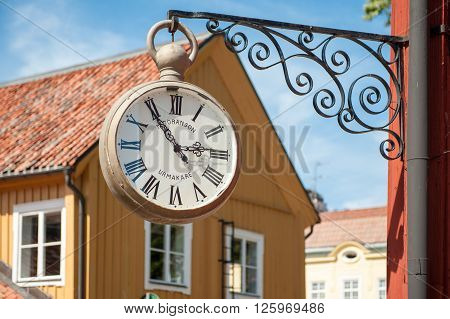 MARIEFRED, SWEDEN - AUGUST 4: Vintage clock on August 4, 2011 in Mariefred. This historic idyllic small town on Lake Mälaren is a popular tourist destination during summer