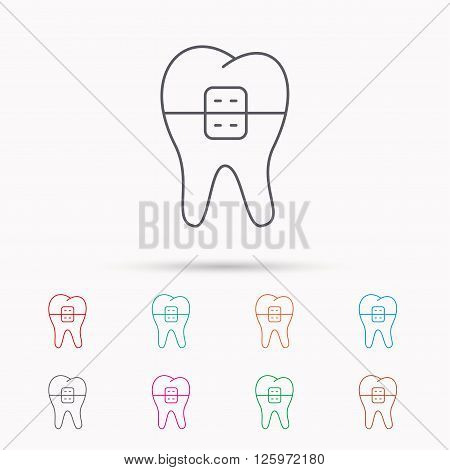 Dental braces icon. Tooth healthcare sign. Orthodontic symbol. Linear icons on white background.
