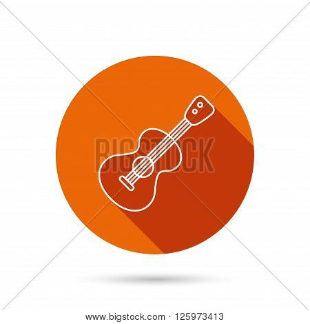 Guitar icon. Musical instrument sign. Band guitarist symbol. Round orange web button with shadow.