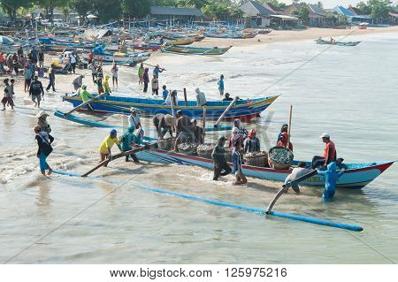 Bali Indonesia Apr 5 2016 : Morning scene of daily activities at Jimbaran village pictured on Apr 5 2016 in Bali Indonesia. Jimbaran village is among famous place to see fisherman life in Bali.
