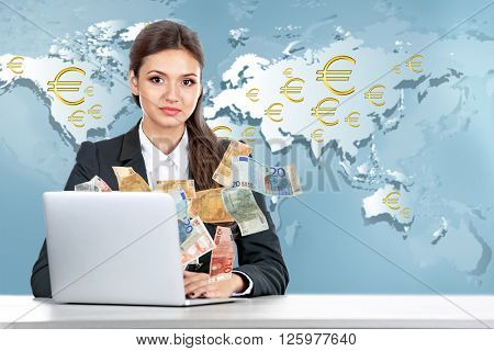 Financial concept. Make money on the Internet. Business lady with laptop on world map background